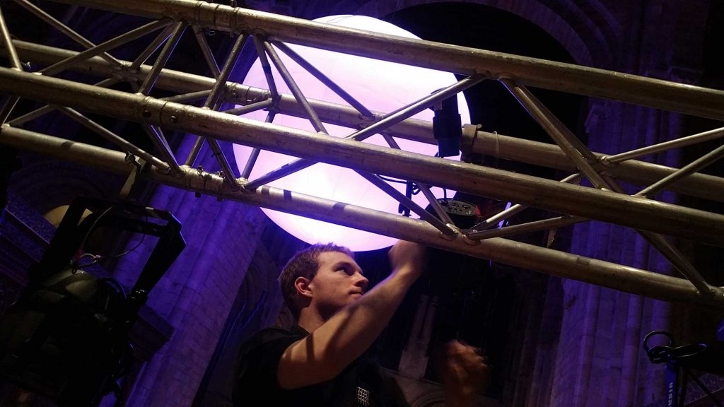 Working on Lighting Truss Volunteer